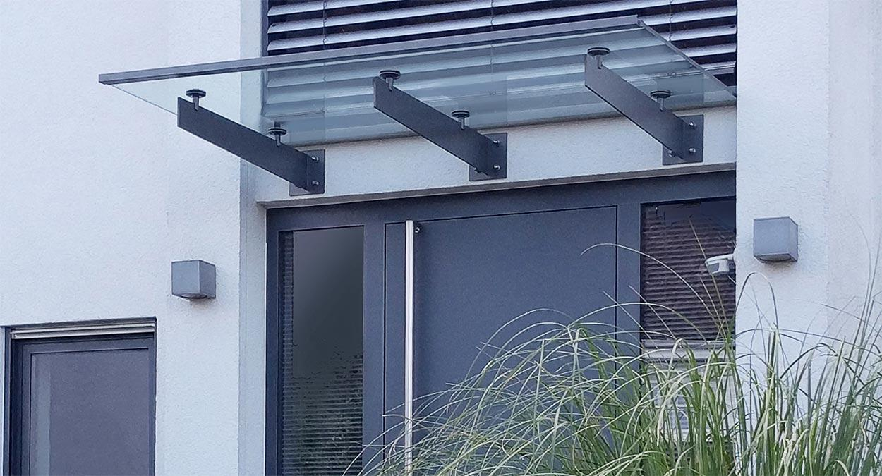 glas vordach spada mit individuellen edelstahl tr gern glasprofi24. Black Bedroom Furniture Sets. Home Design Ideas