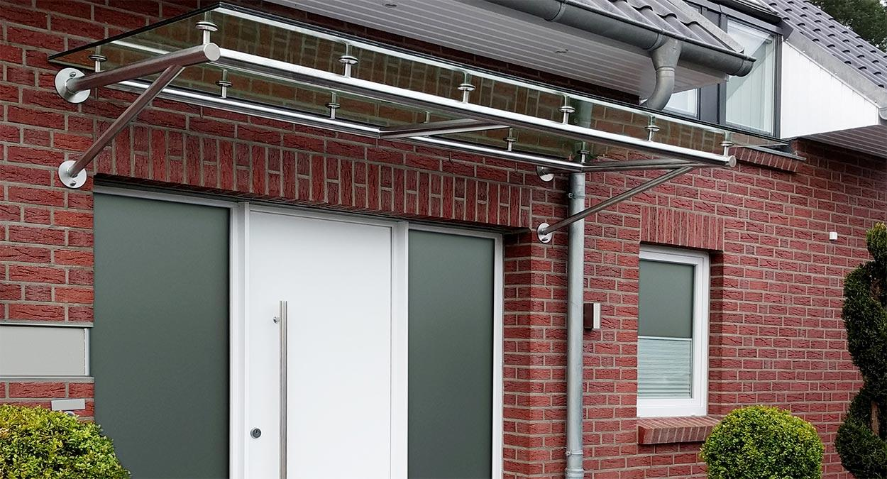 glas vordach trave mit rohrtr ger konstruktion glasprofi24. Black Bedroom Furniture Sets. Home Design Ideas