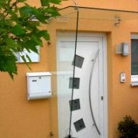 klarglas seitenwindschutz f r die haust r. Black Bedroom Furniture Sets. Home Design Ideas