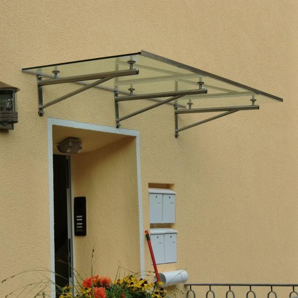 haust rvordach aus glas mit runden vordachhaltern aus edelstahl. Black Bedroom Furniture Sets. Home Design Ideas